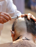 Male who will be monk shaving hair for be Ordained. To new monk Royalty Free Stock Images