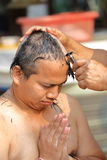 Male who will be monk shaving hair for be Ordained. To new monk Stock Images