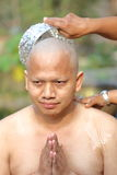 Male who will be monk shaving hair for be Ordained. To new monk Royalty Free Stock Image