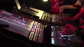 Male and woman hands using a two sound digital mixer at a concert stock video footage