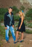 Male and women  looking at camera. Couple on nature in black and blue clothes   looking at camera Royalty Free Stock Photos