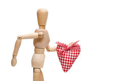 Male wooden figure is holding a red heart. Male wooden figure is holding a red checkered heart Stock Photography