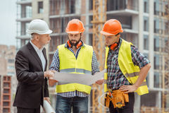 Male work building construction engineering occupation project. Male work building construction engineering occupation blueprint discussion Stock Image