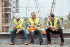 Male work building construction engineering occupation project. Male work building construction engineering occupation eating sandwiches Stock Photography