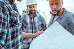 Male work building construction engineering occupation project. Male work building construction engineering occupation holding blueprint Stock Photography
