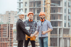 Male work building construction engineering occupation project. Male work building construction engineering occupation shaking hands Royalty Free Stock Photo