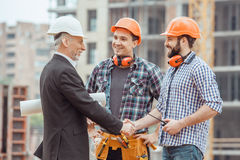 Male work building construction engineering occupation project. Male work building construction engineering occupation shaking hands Stock Images