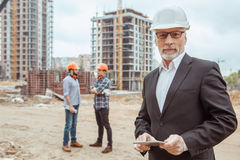 Male work building construction engineering occupation project. Male work building construction engineering occupation using digital device Royalty Free Stock Photo