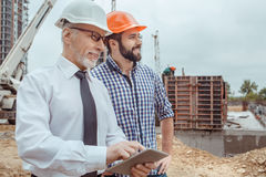 Male work building construction engineering occupation project. Male work building construction engineering occupation using digital device Royalty Free Stock Images