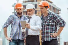 Male work building construction engineering occupation project. Male work building construction engineering occupation using digital device Stock Image
