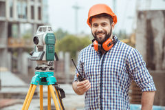 Male work building construction engineering occupation project. Male work building construction engineering occupation using theodolite Royalty Free Stock Images