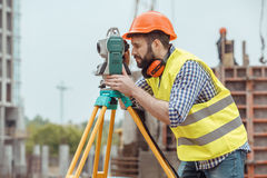 Male work building construction engineering occupation project. Male work building construction engineering occupation using theodolite Stock Images