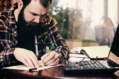 Male work notebook bearded Stock Photos