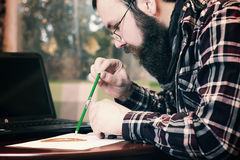 Male work notebook bearded Stock Photography
