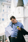 Male workaholic at coffee break. Busy man working on street Royalty Free Stock Images