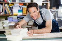 Male Worker Analyzing Papers At Workbench In Royalty Free Stock Photos