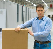 Male worker. Male worker with boxes at warehouse Royalty Free Stock Photography