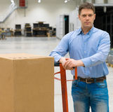 Male worker. Male worker with boxes at warehouse Royalty Free Stock Images