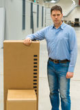 Male worker. Male worker with boxes at warehouse Stock Images