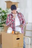 Male worker checking box. Male worker checking a box Stock Photo
