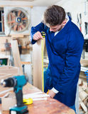 Male worker checking measurements Royalty Free Stock Photography