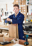 Male worker checking measurements Stock Image