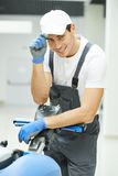 Male worker cleaning business hall Royalty Free Stock Photography