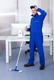 Male worker cleaning floor Royalty Free Stock Image