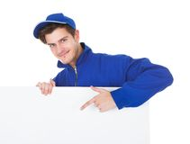 Male worker cleaning floor Royalty Free Stock Images