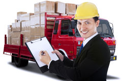 Male worker with clipboard and logistic truck Royalty Free Stock Photography