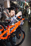 Male worker collects sports bike Stock Photos