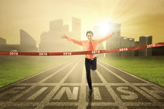 Male worker crossing the finish line Royalty Free Stock Image
