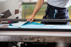 Male Worker Designing Paper In Factory. Midsection of male worker designing paper in factory Stock Photos
