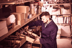 Male worker displaying sanitary engineering details Stock Photography