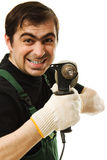 Male worker with an electric dril Royalty Free Stock Photo