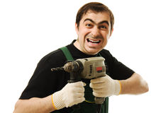 Male worker with an electric dril. L on a white background Royalty Free Stock Photo