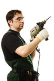 Male worker with an electric dril. L on a white background Royalty Free Stock Images