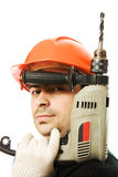 Male worker with an electric dril. L on a white background Royalty Free Stock Photos