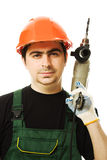 Male worker with an electric dril. L on a white background Stock Image