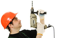 Male worker with an electric dril Stock Images