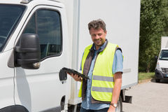 Male worker in front truck using mobile phone Royalty Free Stock Photography