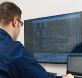 Male worker. Male worker in glasses in thermal plant's control room Royalty Free Stock Photo