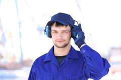 Male worker with headphones outdoors. Hearing protection equipment Stock Photos