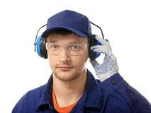 Male worker with headphones. On white background. Hearing protection equipment Royalty Free Stock Photo