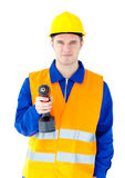 Male worker with helmet holding boring machine. Young male worker wearing helmet and holding boring machine against white background Stock Photo
