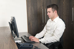 Male worker at a helpdesk Stock Images