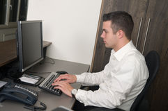 Male worker at a helpdesk Royalty Free Stock Photography