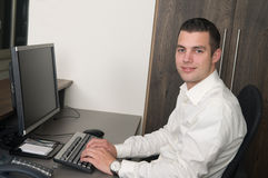 Male worker at a helpdesk Stock Photo