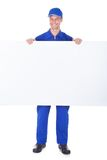 Male worker holding blank placard Stock Photo