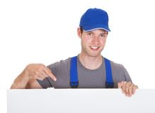 Male worker holding blank placard Royalty Free Stock Images